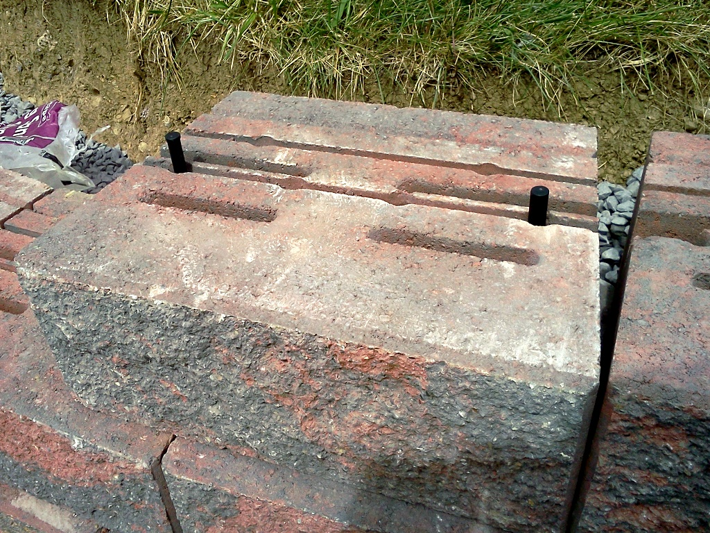 Concrete block retaining wall august involved sweating Cinder block retaining wall