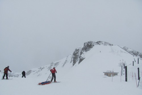 I like that the ski patrol is going after the guy before he's even fallen (or started downhill or gotten to the top).